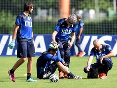 Salvatore Sirigu of Italy sits on the pitch during a training session