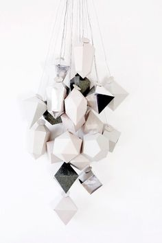 i am ready for december     this years advent calendar    made out of 24 paper cubes    in all kinds   of different shapes...