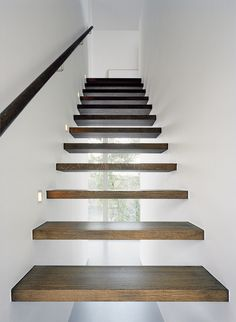 Floating staircase. looks really cool.  i dont think it would work with my decore and style but i think its really neat to look at. great conversation piece for sure. [ Wainscotingamerica.com ] #staircase #wainscoting #design