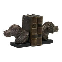 """Cast iron and marble bookends with bronze finish. Dimensions: 5.25""""h x 3.75""""d x 7""""w"""