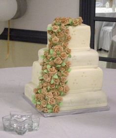 Four tiers, square, all white and beige roses.