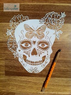 A beautifully intricate Female Sugar Skull with Butterfly and flower details.