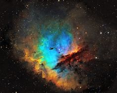 NGC 281 also known as the The Pac-Man Nebula appears to be devouring its way through the constellation of Cassiopeia.