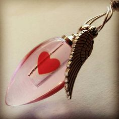 Check out this item in my Etsy shop https://www.etsy.com/listing/210194285/heart-with-angel-wing-cremation-ash-vile