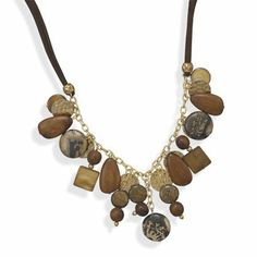 """18""""+2"""" Multibead Suede and Gold Plated Fashion Necklace Silver Castle Jewelry. $34.74. 18"""" + 2"""" extension double strand brown suede and gold plated fashion multibead necklace. The beads include 14mm brown shell, 15mm x 25mm wood, 20mm artistic jasper, 10mm wood, 15mm hammered gold plated disc, 13mm bronzite and 15mm square brown shell. The necklace has a lobster clasp closure. Fashion jewelry contains base metal."""
