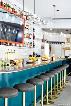 orange mirror + blue bar with lots of white. love the brass trim on the bar top and those lights! This is what a bar should look like. Bar Interior, Restaurant Interior Design, Interior Decorating, Decorating Ideas, Decorating Websites, Commercial Design, Commercial Interiors, Blue Bar, Condo