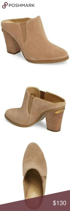 New! Michael Kors Pointed-Toe Suede Mules Slides MICHAEL Michael Kors' Braden suede mules have a first-rate silhouette for work or play with slip-on styling that won't slow you down.A sleek structured design rested on firm stacked heels.   Brand New With Box  Stacked heel, 3.5 inches  Point toe  Suede leather upper  Side elastic goring  Slip-on style  Synthetic lining and sole  Padded insole  Retails for $150 Michael Kors Shoes Mules & Clogs