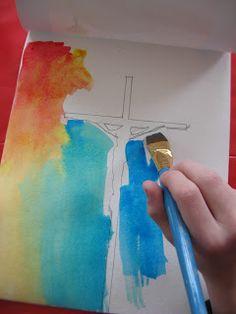crucifixion pintura. Se perfila un crucifijo con lápiz y se pinta alrededor con pinturas, Al final se pinta la cruz de negro y terminado