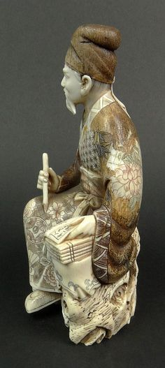Japanese Carved Ivory Seated Scholar Figure. Signe - by Kodner Galleries -