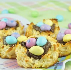 Easy Easter dessert recipe for Coconut Macaroon Nutella Easter Nests filled with Nutella and topped with peanut M&M's to look like a bird's nest and eggs!