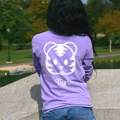 Our signature Long Sleeve Tiger T-shirt with a white Tigris Logo on a Berry Long Sleeve shirt. We donate 10% of the proceeds to help save the tigers.