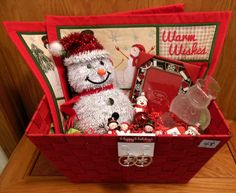 Snowman Basket!  Features sparkly snowman, placemats, napkin holders, ornaments, picture frame, and glass snowman plate.