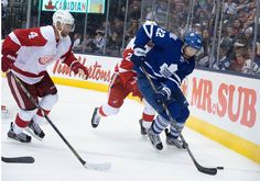 CrowdCam Hot Shot: Detroit Red Wings defenseman Jakub Kindl and Toronto Maple Leafs center Joe Colborne battle for a puck during the third period in a game at the Air Canada Centre. The Toronto Maple Leafs won 3-1. Photo by Nick Turchiaro