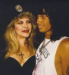 Stevie ~ ☆♥❤♥☆ ~  beautiful and buxom and wearing a large silver cross, and Steven Tyler from Aerosmith; a candid photo taken in 1990 ~ 'Behind The Mask' era