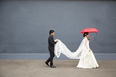 Rain and red umbrellas. Wedding day photographs. Durban City