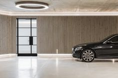 The Most Insane Garage We've Ever Seen in Sydney | Man of Many Underground Garage, Smooth Concrete, Large Format Tile, Curved Walls, Garage Design, Garage Interior Design, Car Garage, Dream Garage, Modern Luxury