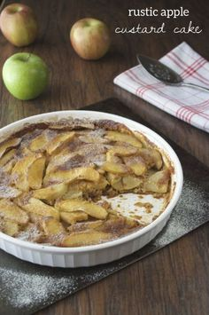 Paleo Rustic Apple Custard Cake. Creamy gluten-free cake filled with a mixture of tart and sweet apples and topped with homemade powered sugar!