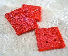 Red polymer clay buttons by Toy Story Nutty
