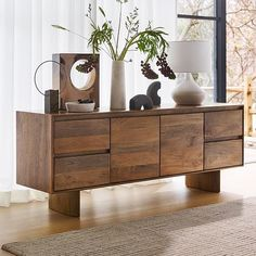 We designed the Anton Media Console to showcase its rich, natural wood grain and thoughtful craftsmanship. Crafted from durable, solid mango wood, it's detailed with softly eased edges, simple slab legs and inset drawer pulls. Furniture For You, Dining Room Furniture, Modern Furniture, Rustic Furniture, Furniture Design, Oak Panels, Modern Console Tables, Ceramic Table Lamps, Room Planning