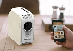 The Reminiscence Digital Photo Album Boasts Built-in Photo Printer and Beam Projector