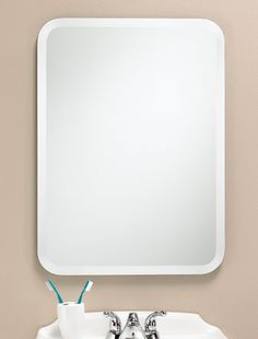 302 – Rectangle Frameless mirror with 1″ beveled edge and rounded corners.22″ wide, 30″ high and 3/8″ deep