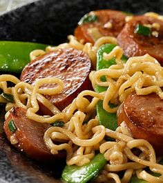 Sausage & Ramen Noodle Stir-Fry – This dorm-room classic is graduating. Ditch the seasoning packet, and create your own stir-fry recipe with garlic, snow peas, sesame dressing, and turkey sausage. Garlic Recipes, Stir Fry Recipes, Sausage Recipes, Pork Recipes, Asian Recipes, Cooking Recipes, Kraft Recipes, Sausage Noodle Recipe, Kraft Foods