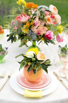 Obsessed with this colorful DIY citrus floral centerpiece perfect for a summer wedding.