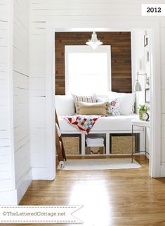 Hallway Update | The Lettered Cottage. Such a cozy little reading nook! Like the quilt and IKEA pillow, along with the storage under the daybed.