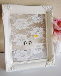 earring organizer studs--lace background--can't hang/would need some way to access the back...