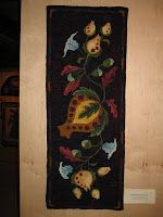 Pomegranate Runner hooked by Christine Walker Bird.   Designed by Searsport Rug Hooking