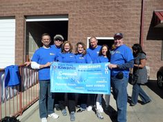 Pikes Peak Kiwanis at a Kids Against Hunger Packaging Event with their new word-picture banner.