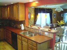Open up the kitchen with a connection to the family room