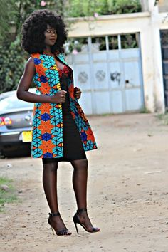 Double layered sleeveless ankara coat with  bold blue, orange and yellow prints.  this coat will make you stand out at any occasion.  xs-bust: 30-33 waist: 24-25 hips 34-35  s - bust: 34-36 waist: 26-28 hips: 36-40  m - bust: 37-39 waist: 29-31 hips: 40-44  l - bust: 40-42 waist: 32-34 hips: 45-49  1x - bust: 43-45 waist: 36-38 hips: 50-54  2x - bust: 46-48 waist: 40-42 hips: 55-59  3x - bust: 49-51 waist: 44-46 hips: 60-64 Ghana Fashion, African Fashion Ankara, African Print Fashion, Africa Fashion, African Wear, Blazers For Women, Coats For Women, Sleeveless Blazer, Ankara Designs