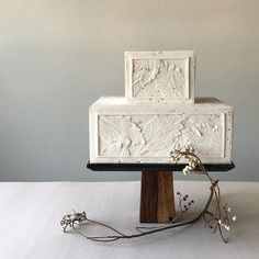Earthily modern wedding cake inspired by carved stone