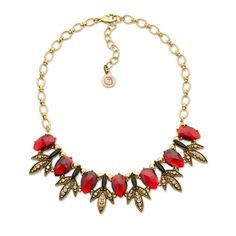 Vamp up your classy style with this red and black crystal vintage bib necklace. The crystal centerpieces are set off by rhinestone-lined metal petals. To add to the romance, try pairing this beauty with the Leading the Parade earrings from Kimmie's line.