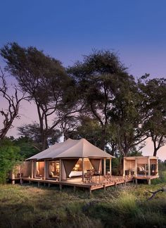 &Beyond Nxabega Okavango Tented Camp has nine luxurious suites, including a family unit comprised of two suites joined by a deck. Each room has both indoor and outdoor showers as well as an outdoor sala, perfect for cool afternoon naps or between-activity game viewing. Slightly elevated, overlooking a lagoon frequented by hippo and elephants, each room offers the utmost in vistas and privacy. Luxury at it's best. Timbuktu Travel.