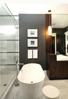 Love the charcoal wall with the pictures and the shower tile that match...