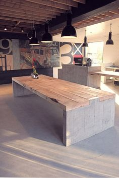 Concrete & wood table at Deus, Venice Beach Concrete Furniture, Concrete Wood, Concrete Design, Diy Furniture, Furniture Design, Concrete Table Top, Wood Table Design, Furniture Board, Furniture Plans