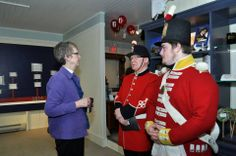 Board Chairperson, Linda Preston, greets soldiers from the 100th Regiment. - Family Day, February 17, 2014