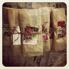 Lovely packages! Use old sewing pattern papers, twine and a pretty picture to wrap a crafty gift! Get supplies at Flower Factory - www.flowerfactory.com