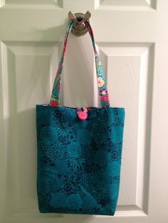Bag for my Mom's dancin' shoes. First one I made with a button closure and is big enough for a pair of shoes and a water bottle.