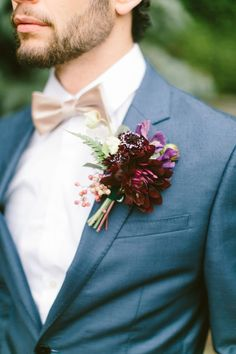 A gorgeous maroon Boutonnière to add a little colour! Shop at Lucy's florists for a beautiful selection of colours to make your special day perfect!