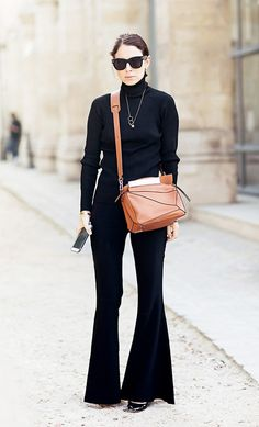 A turtleneck is paired with flares, heels, and a Loewe Puzzle bag