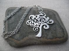 or :  - https://www.etsy.com/listing/113396804/silver-tree-necklace-tree-of-life?ref=related-1  -https://www.etsy.com/fr/listing/113389479/silver-tree-necklace-tree-of-life-silver?ref=shop_home_active_3