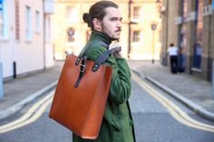 Parka London and fellow UK brand The Leather Satchel Company come together to create two quality leather bags, crafted in their Liverpool workshop. Leather Satchel, Leather Backpack, Uk Brands, Parka, Bucket Bag, Bag Accessories, Take That, London, Unisex