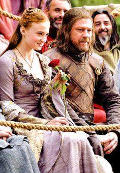 "Sansa Stark (Sophie Turner) and Ned Stark (Sean Bean). Look at Ned's face. ""A Stark girl gets flowers at a tourney."" Game of Thrones. Eddard Stark, Ned Stark, Winter Is Here, Winter Is Coming, Got Serie, Game Of Thrones Sansa, Game Of Thrones Costumes, Sean Bean, My Champion"