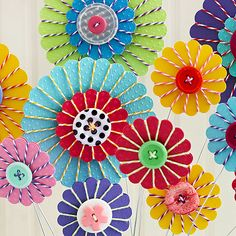 Plant a garden of colorful blooms by embellishing punched flower shapes with baker's twine