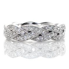 Created of seamlessly intertwining elements the Legato is elegantly braided with micro pavé diamonds. Each segment is edged with milgrain texture along the woven pattern adding dimension to the crisscross design. This unique woven band can be worn as a wedding band or a fashion ring.