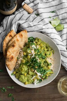 An easy weeknight green curry using store-bought curry paste mixed with cilantro and coconut milk along with chickpeas and potatoes.