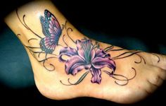Check out our amazing lily tattoo designs with meanings. Here we have listed the best lily tattoo ideas that look beautiful and elegant on anyone's body Butterfly Ankle Tattoos, Lily Flower Tattoos, Tattoos For Women Flowers, Foot Tattoos For Women, Butterfly Tattoo Designs, Foot Tattoos Girls, Unique Butterfly Tattoos, Flower Tattoo Foot, Tattoo Flowers